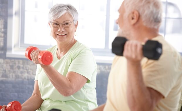 older couple maintaining pain at home with exercise